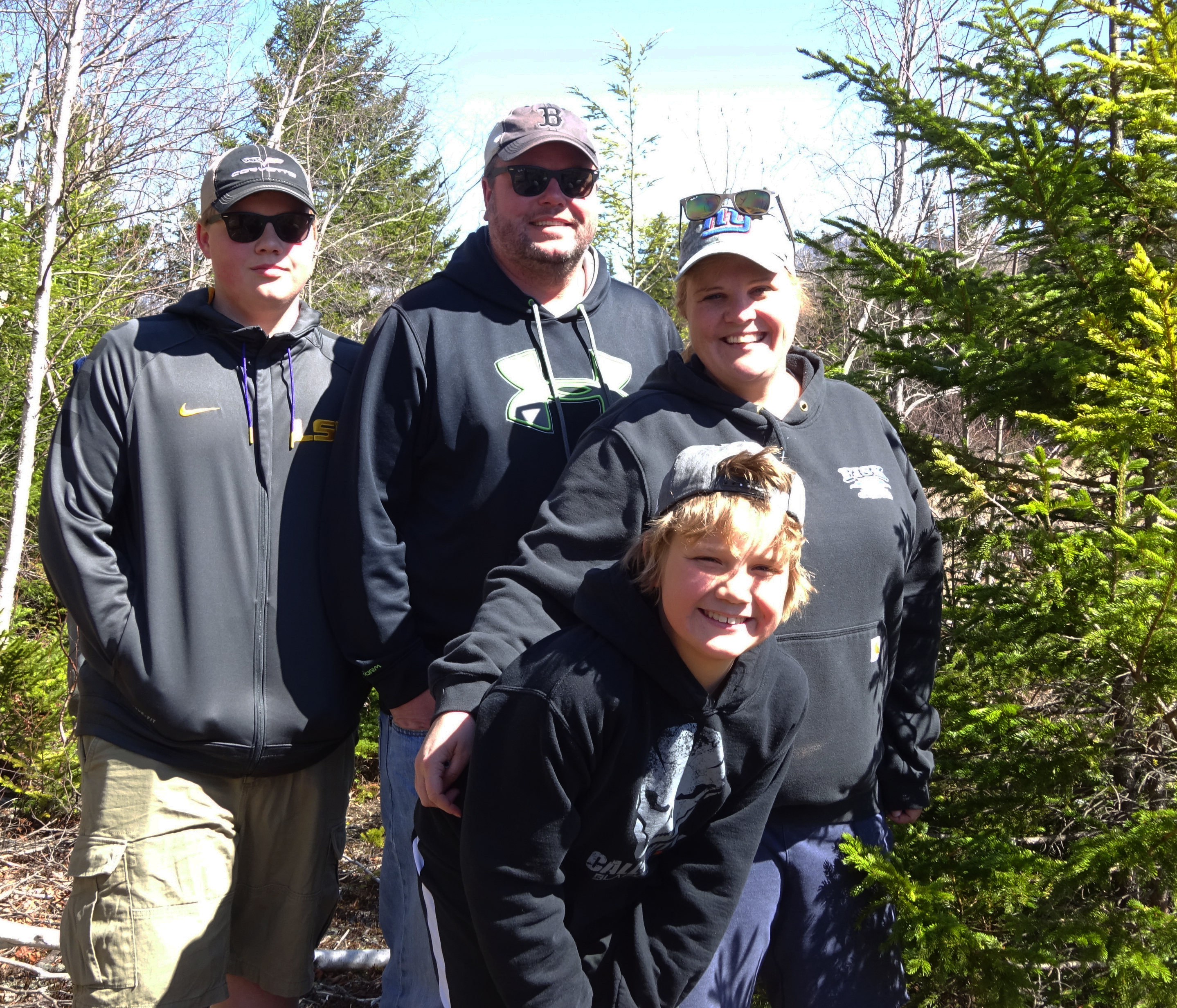 Family from Gorham has just found a geocache.April 2016